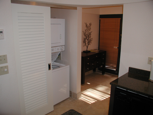 Vestibule, closet and washer dryer combo unit in the one bedroom condo, Westin St John Resort